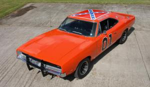 I liked the car because it was orange. I had no idea how much that flag on top of the car had scarred my family and others.